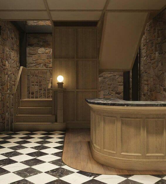 Basement cellar lobby desk with cobblestone walls
