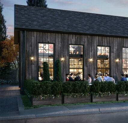exterior patio of Greystones Restaurant with people dining by patio light at dusk