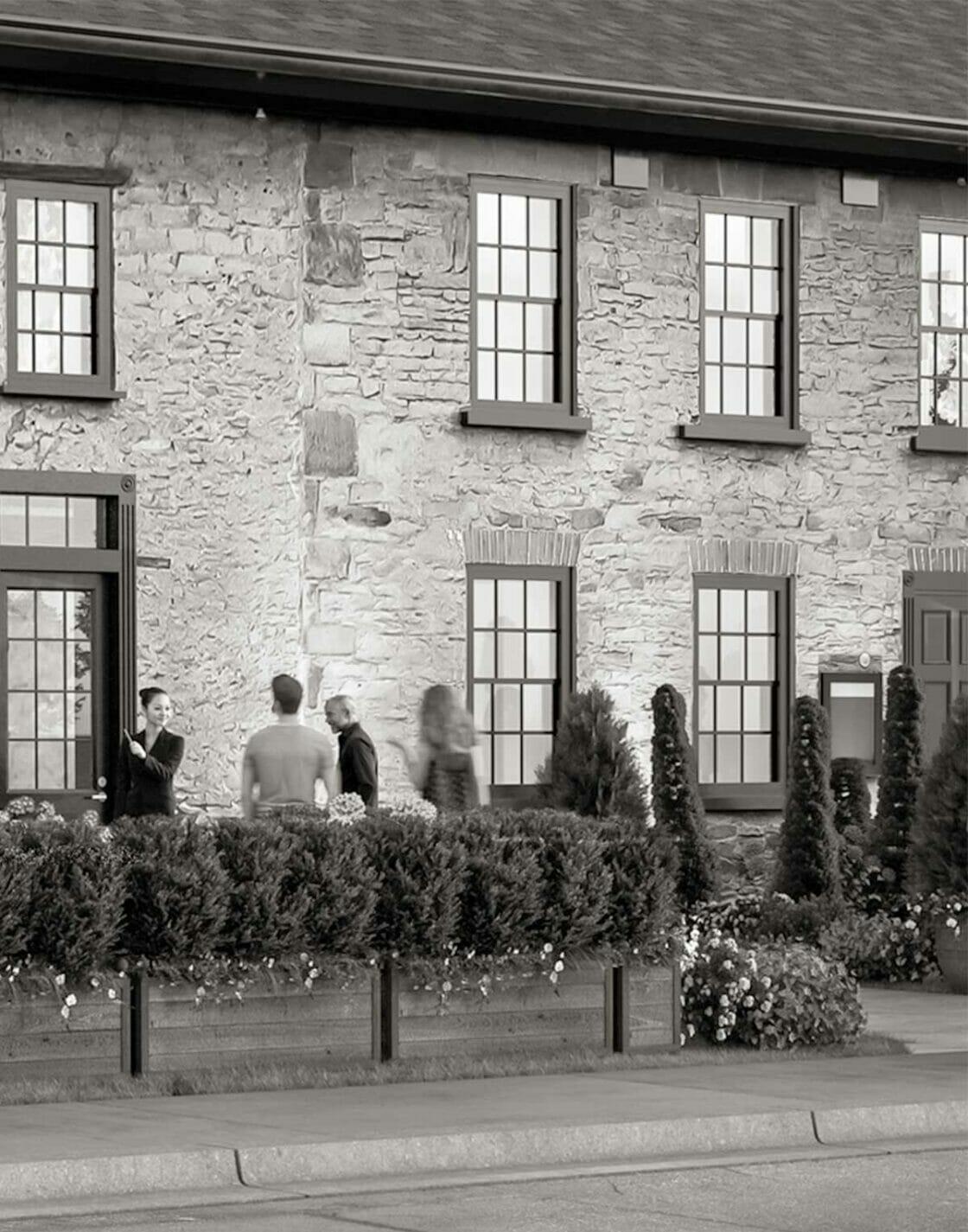 black white exterior photo of Greystones