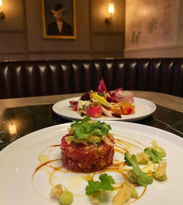 Two dishes of tuna tartar on white plates